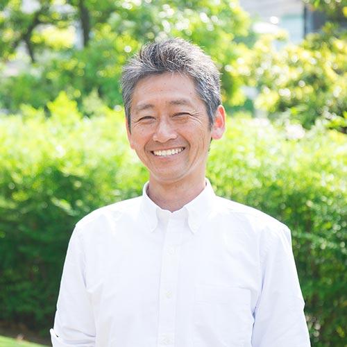man smiling in park